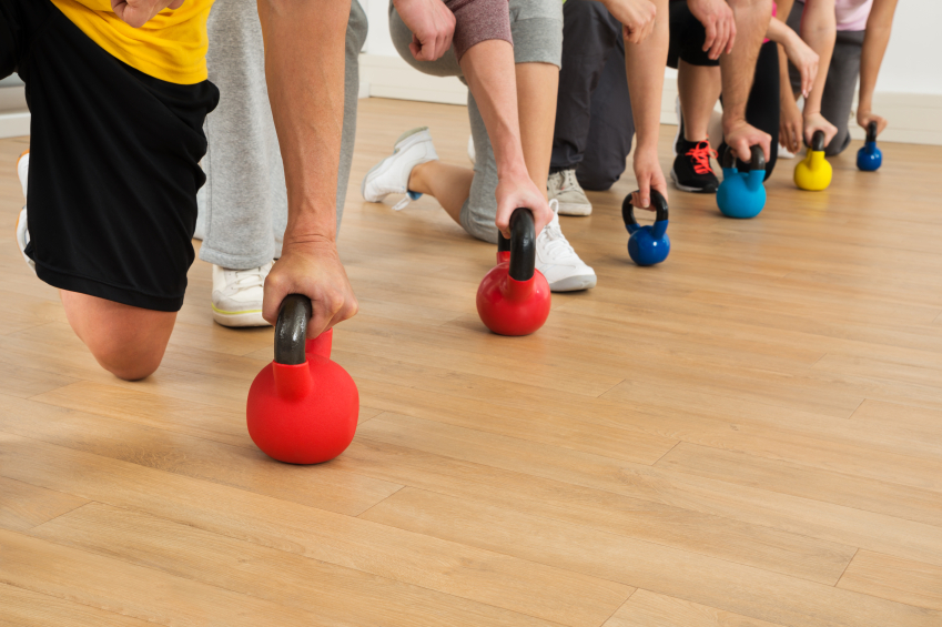 People Holding Colorful Kettle Bell